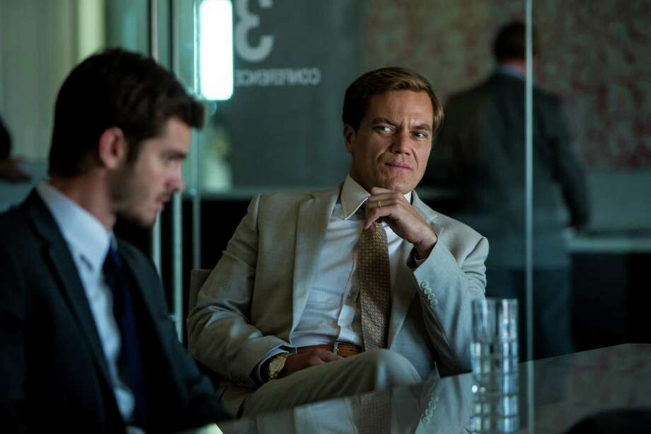 """In this image released by Broad Green Pictures, Andrew Garfield portrays Dennis Nash, left, and Michael Shannon portrays Rick Carver in a scene from """"99 Homes."""" (Hooman Bahrani/Broad Green Pictures via AP) ORG XMIT: NYET130 Photo: Hooman Bahrani / Broad Green Pictures"""