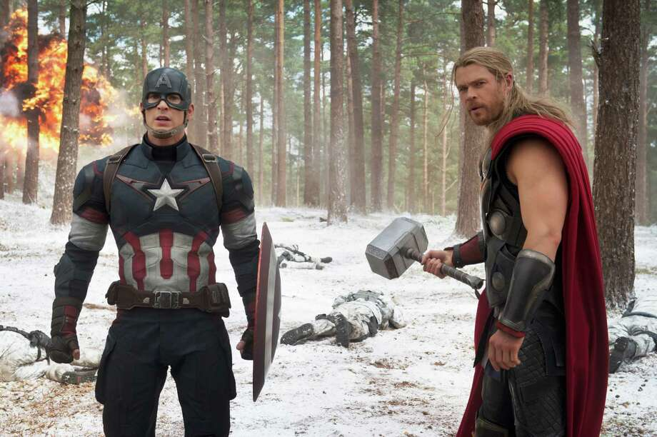 "This photo provided by Disney/Marvel shows, Chris Evans, left, as Captain America/Steve Rogers, and Chris Hemsworth as Thor, in a scene of the new film, ""Avengers: Age Of Ultron."" The movie releases in the U.S. on May 1, 2015.  (Jay Maidment/Disney/Marvel via AP) ORG XMIT: CAET406 Photo: Jay Maidment / Disney/Marvel"