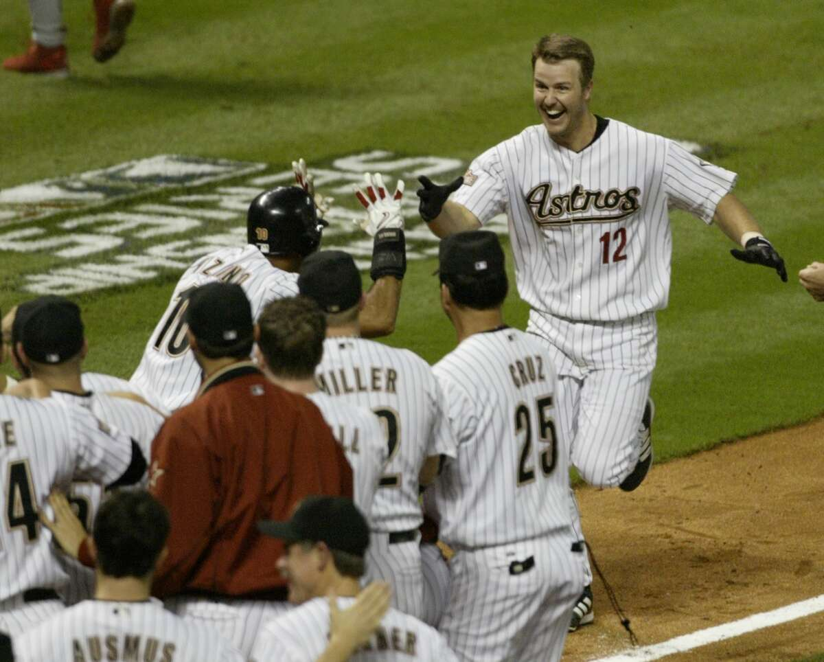 Jeff Kent (12) heads home after his dramatic three-run homer to win Game 5 of the 2004 National League Championship Series against the Cardinals. The win put the Astros one victory shy of the World Series, but they dropped the final two games in St. Louis.