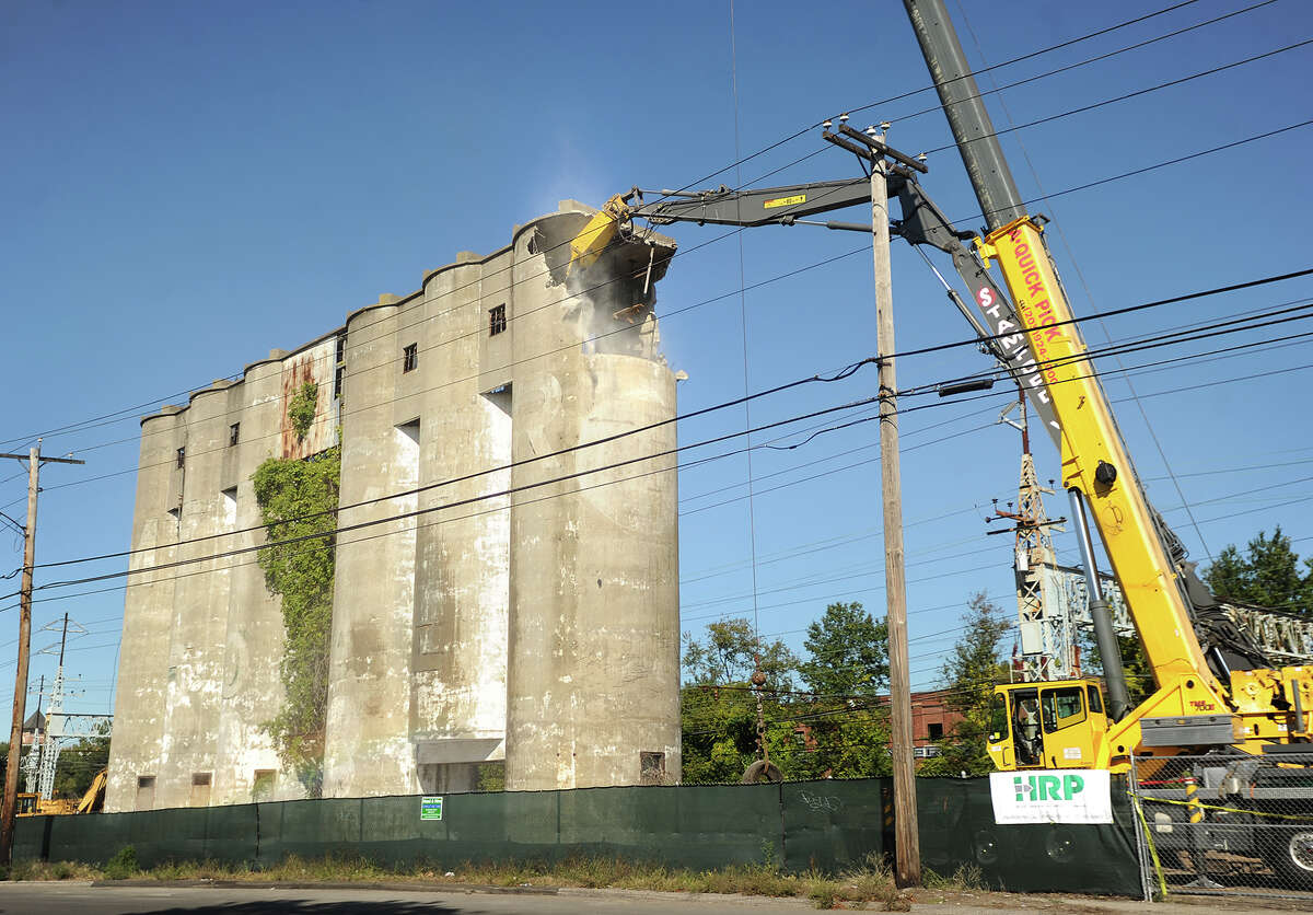 Demolition begins on the old Mercer Coal towers on Stratford Avenue in Stratford on Wednesday, October 7, 2015. Demolition is scheduled to take at least a week.