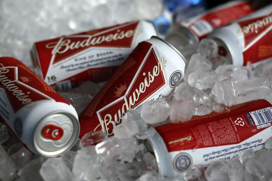 The proposed merger of two brewing giants is on hold. Photo: Gene J. Puskar, Associated Press