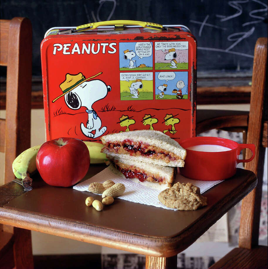 Peanut butter and jelly sandwiches, with protein, fat and carbohydrates, are the equivalent of a simple man's recovery shake. Photo: BEN BENSCHNEIDER, KRT / SEATTLE TIMES