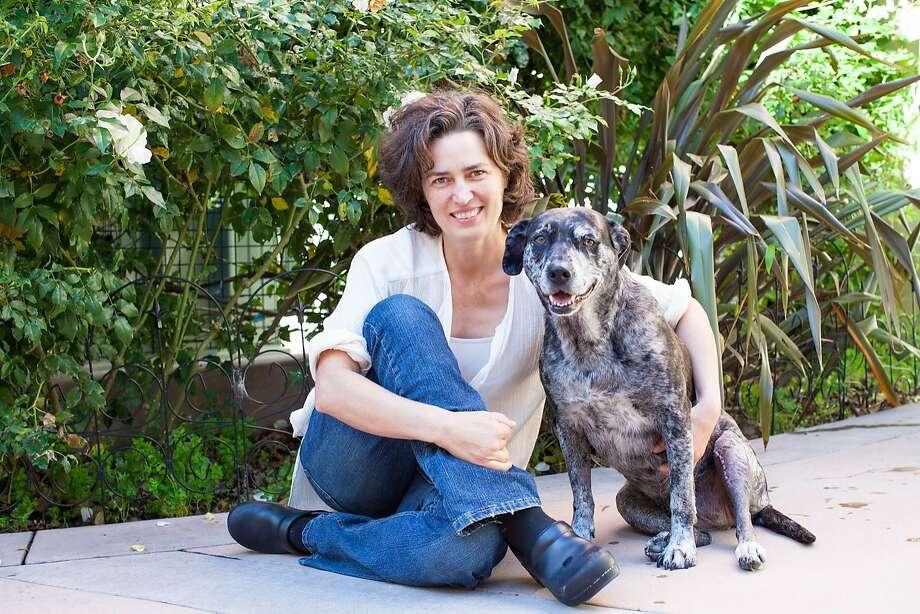 Jennifer Scarlett. a veterinarian with the San Francisco SPCA, and her dog, Huri. Photo: Courtesy Of San Francisco SPCA