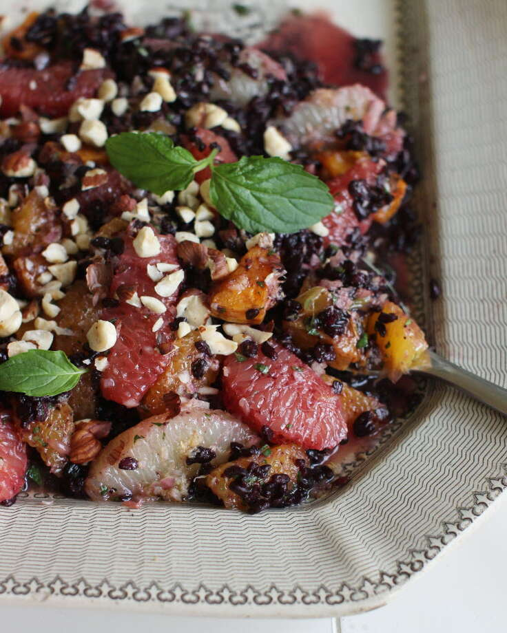 This Sept. 21, 2015 photo shows black rice autumn salad in Concord, NH. Rice salads are the perfect side dish that can be turned into a main meal just by adding some rotisserie chicken, tofu or fish. (AP Photo/Matthew Mead)