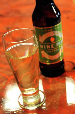 A fresh poured glass of Nine Pin Cider on Friday Feb. 14, 2014 in Albany, N.Y. (Michael P. Farrell/Times Union) ORG XMIT: MER2014021416585753 Photo: Michael P. Farrell / 00025759A
