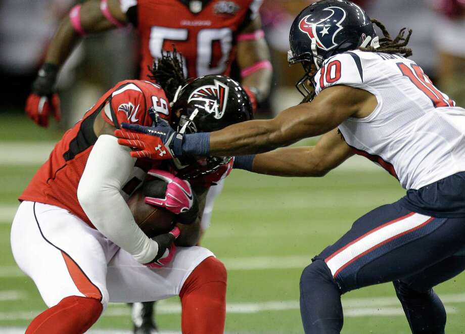 Falcons defensive tackle Jonathan Babineaux (95) comes down with an interception on a pass intended for Texans wide receiver DeAndre Hopkins. Photo: Brett Coomer, Staff / © 2015  Houston Chronicle