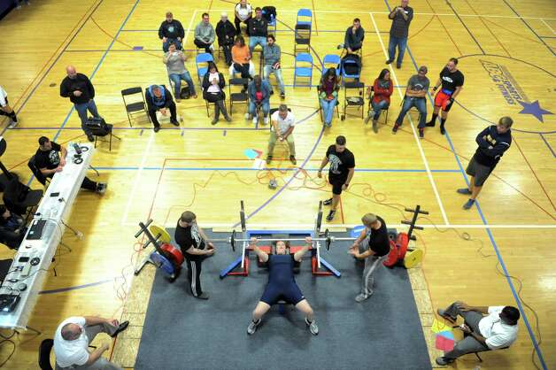 Claire Hoff bench presses during a powerlifter competition at  ABC Sports and Fitness on Saturday Oct. 3, 2015 in Latham , N.Y.  (Michael P. Farrell/Times Union) Photo: Michael P. Farrell / 10033616A