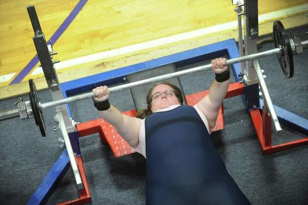 Jessica Roberts bench presses during a powerlifter competition at ABC Sports and Fitness on Saturday Oct. 3, 2015 in Latham , N.Y.  (Michael P. Farrell/Times Union) Photo: Michael P. Farrell / 10033616A