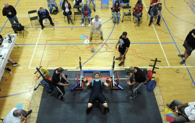 PJ Uppal bench presses during a powerlifter competition at  ABC Sports and Fitness on Saturday Oct. 3, 2015 in Latham , N.Y.  (Michael P. Farrell/Times Union) Photo: Michael P. Farrell / 10033616A