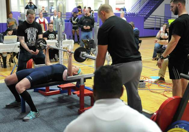 Katie Moskal bench presses during a powerlifter competition at  ABC Sports and Fitness on Saturday Oct. 3, 2015 in Latham , N.Y.  (Michael P. Farrell/Times Union) Photo: Michael P. Farrell / 10033616A