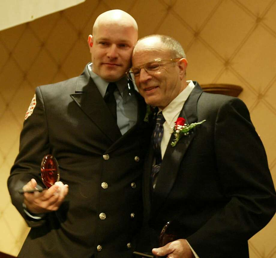 New Canaan Firefighter Michael Sasser gives his father Duffy Sasser, Sr., a hug , Thu., March 25, 2010, after receiving Good Samaritan awards at the Red Cross Heroes Breakfast at the Trumbull marriott. Photo: Phil Noel, ST / Connecticut Post