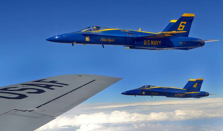 The Blue Angels' Lt. Ryan Chamberlain (6) and Nate Barton (4) fly off of the right wing of a KC-135 of the Kansas Air National Guard's 190th Refueling Wing after receiving fuel from it on Wednesday, Sept. 23, 2015, over New Mexico. (Chris Neal/The Topeka Capital-Journal via AP) Photo: Chris Neal, Associated Press
