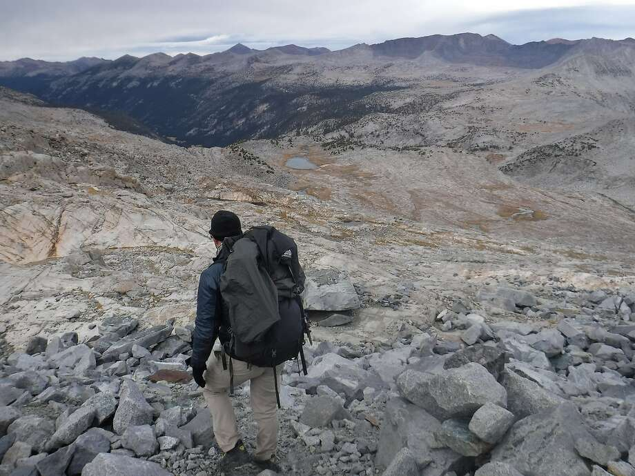 Bevan Bell starts 4,000-foot descent from ridge below Lyell Glacier to base camp (next to small lake on canyon terrace) and beyond to head of Tuolumne Meadows (brown meadow on distant valley floor) Photo: Tom Stienstra, The Chronicle
