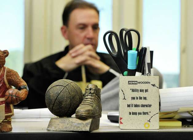 Basketball themed items are seen on his desk as UAlbany basketball coach Will Brown talks about his team during an interview in his office on the UAlbany campus on Tuesday, Oct. 6, 2015, in Albany, N.Y.   The three-time defending America East Tournament champions will begin practice on Thursday.  (Paul Buckowski / Times Union) Photo: PAUL BUCKOWSKI / 10033628A
