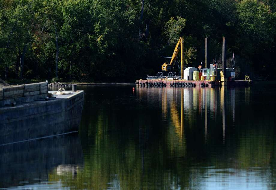 Equipment sits dormant at a PCB dredge site just north of Lock 2 on the Hudson River Monday afternoon, Oct. 5, 2015, in Halfmoon, N.Y. General Electric announced Monday that it has completed dredging in New York's upper Hudson River. (Will Waldron/Times Union) Photo: Will Waldron