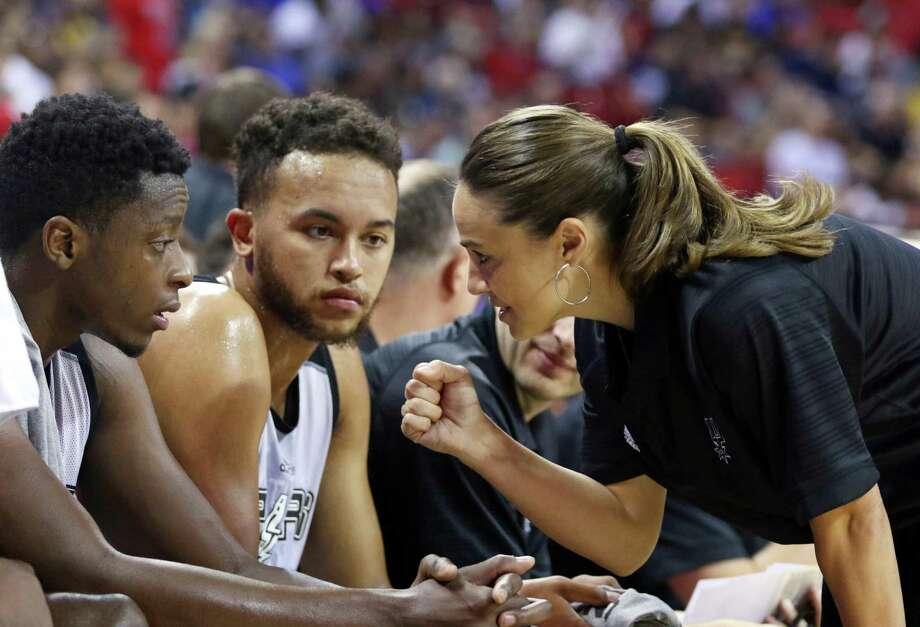 NBA Summer League head coach Becky Hammon talks with San Antonio Spurs' Kyle Anderson, left, and Cady Lalanne during an NBA summer league basketball game against the New York Knicks in Las Vegas on July 11, 2015. Photo: Ronda Churchill /Associated Press / AP