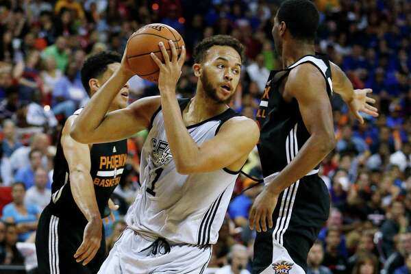 San Antonio Spurs Kyle Anderson passes around the Phoenix Suns during the first half of an NBA summer league basketball game Monday, July 20, 2015, in Las Vegas.