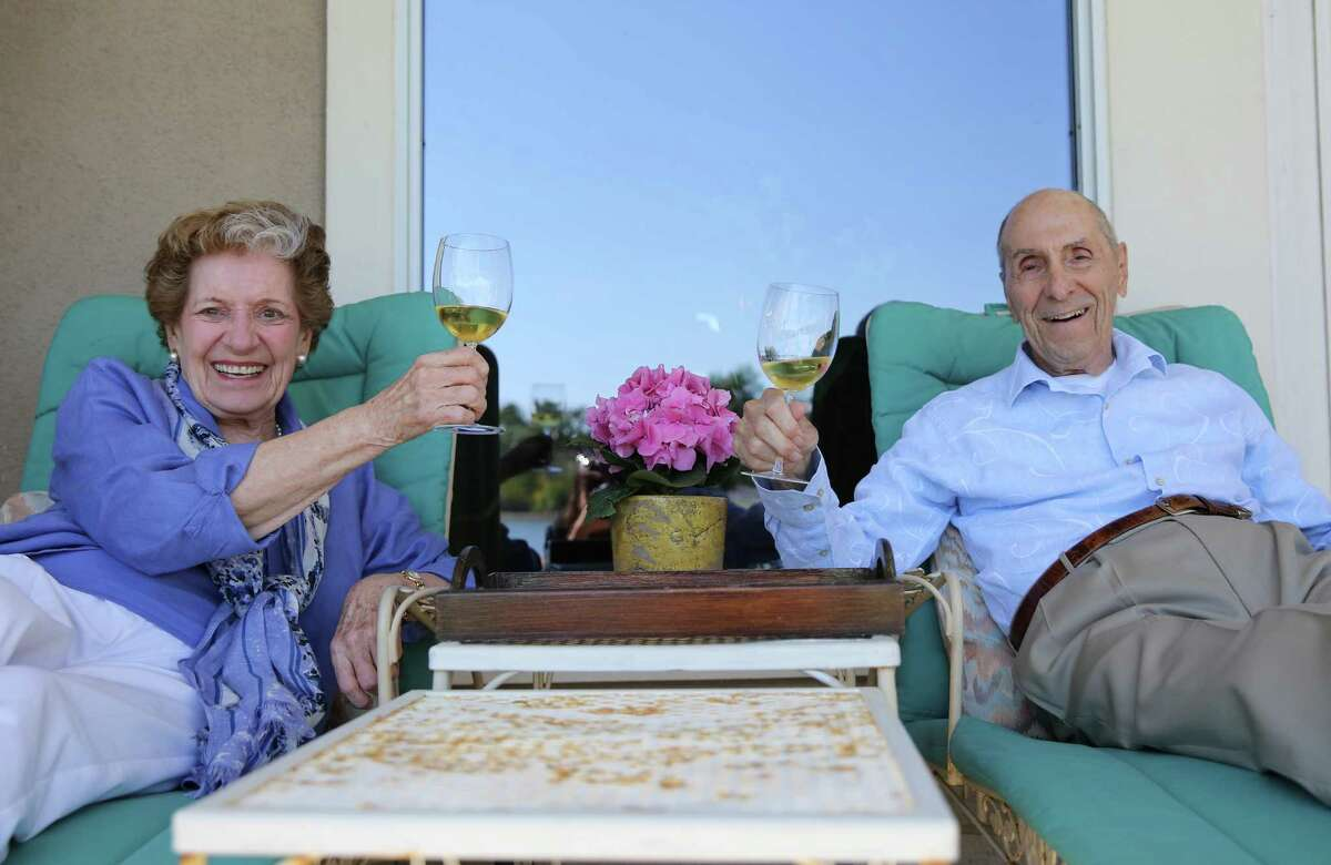 """Margie and Robert """"Jenks"""" Jenkins hoist a glass on their patio, where they spend many evenings watching the sun set. At the time of your own personal sunset, have your house in order, she says."""