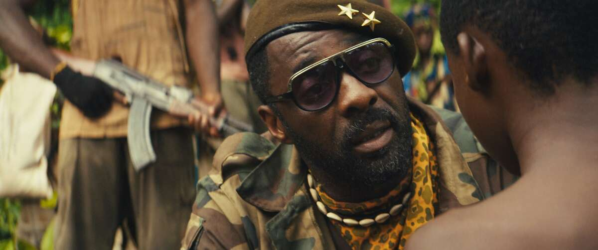"""This photo provided by Netflix shows, Idris Elba,as Commandant, in the Netflix original film, """"Beasts of No Nation,"""" directed by Cary Fukunaga. (Netflix via AP)"""
