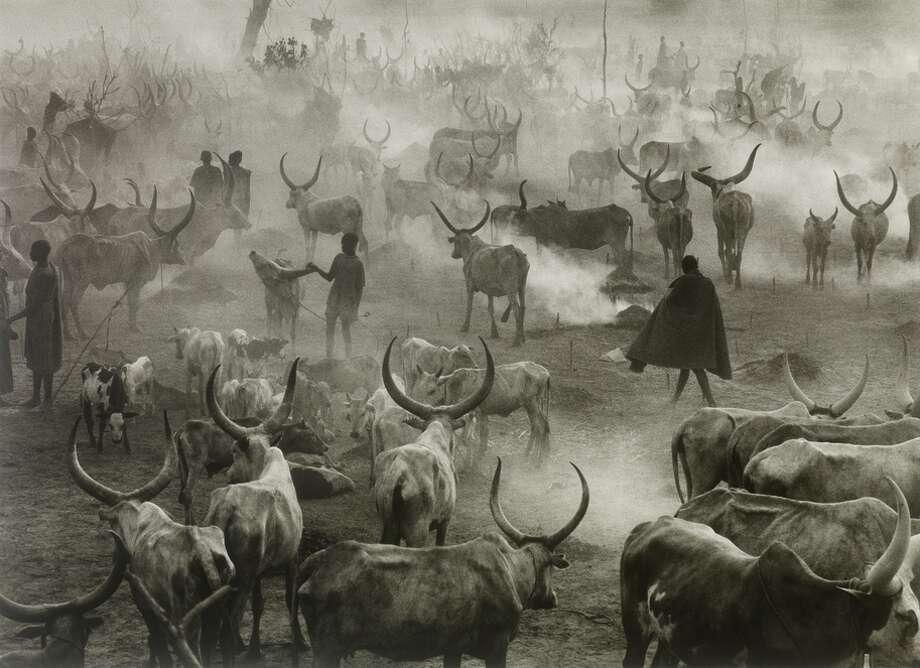"Above: Sebastiao Salgado's 2006 ""Dinka Camp of Amak, Sout hern Sudan"" is in the exhibit. / ONLINE_YES"