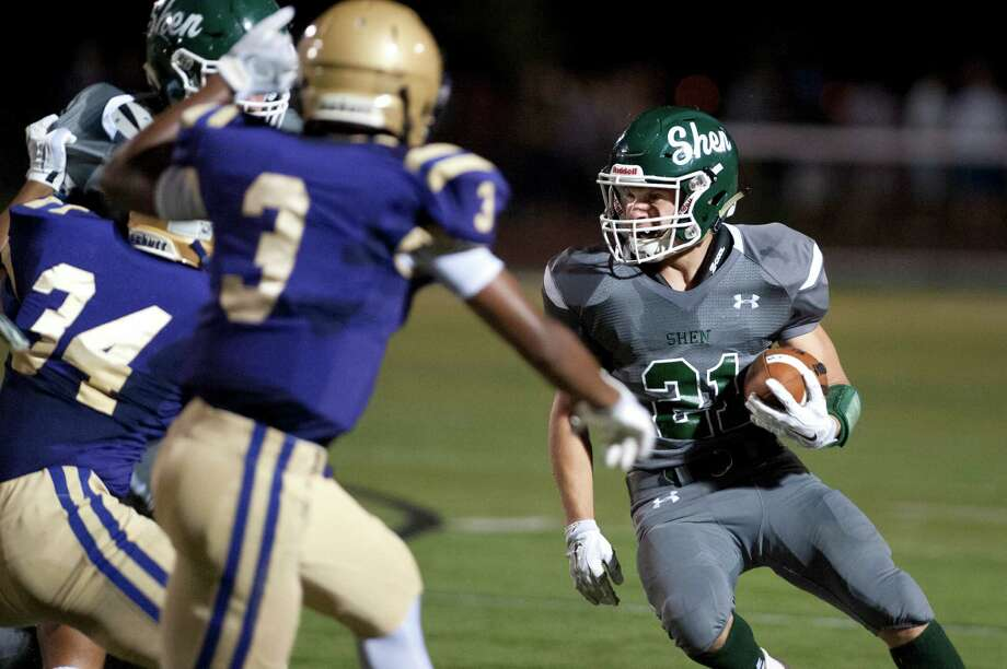 Shen's Carl Fiore, right, carries the ball during their football game against CBA on Friday, Sept. 18, 2015, at Shenendehowa High in Clifton Park, N.Y. (Cindy Schultz / Times Union) Photo: Cindy Schultz / 00033403A