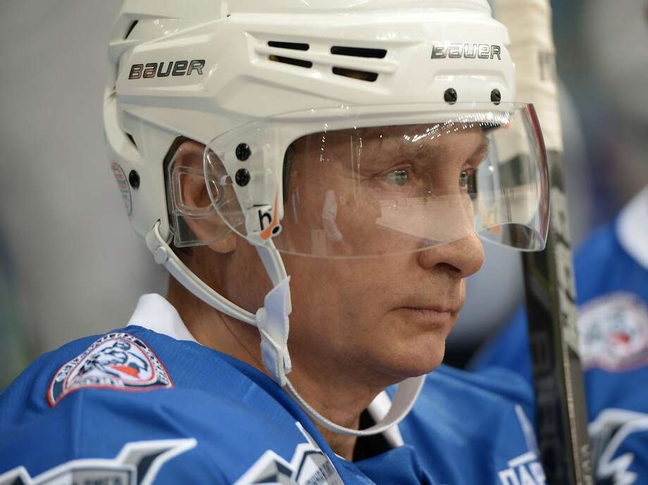 Russian President Vladimir Putin takes part in a hockey match during the opening of a new season of the Night Ice Hockey League in Sochi on October 7, 2015. AFP PHOTO / RIA NOVOSTI / ALEXEI NIKOLSKYALEXEI NIKOLSKY/AFP/Getty Images Photo: Alexei Nikolsky, AFP / Getty Images
