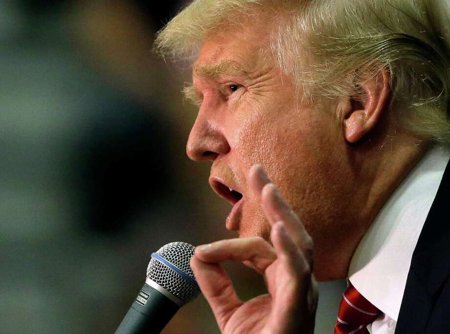 Donald Trump says he can easily solves most problems, but when it comes to guns he is as passive as the rest of the GOP presidential field. Photo: Steven Senne /Associated Press / AP