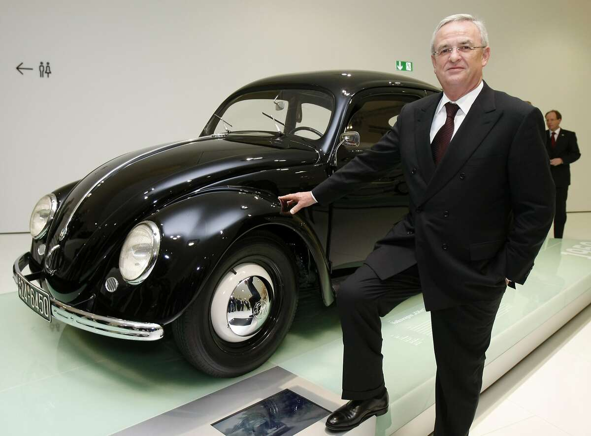 FILE - In this Jan. 28, 2009, file photo Martin Winterkorn, CEO of Volkswagen AG, poses next to a Volkswagen Beetle from 1950 during the inauguration of the new Porsche museum in Stuttgart, Germany. Thanks to Volkswagen, Wolfsburg boomed in West Germany's postwar rebirth and today the town and the company are inseparable. (AP Photo/Thomas Kienzle, file)