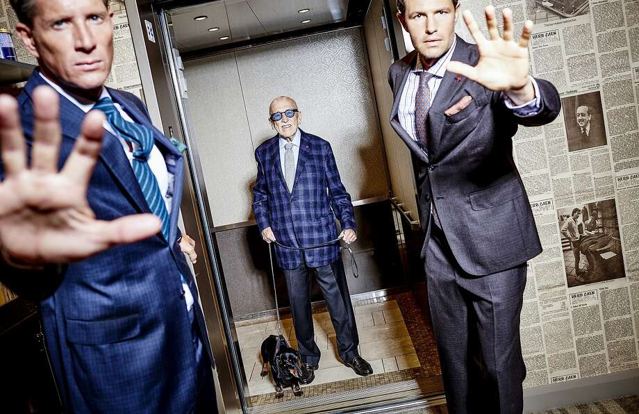 Wilkes Bashford and his dog, Duchess, are seen in the elevator near the Herb Caen Wall at Wilkes Bashford on Monday, Oct. 5, 2015 in San Francisco, Calif.  Christian (left): Brioni suit, $6495; Kiton shirt, $895; Kiton knit tie, $450; tie bar, $125, Isaia pocket square, $125.  Dan (right): Isaia suit $3995; Kiton shirt, $1195; Kiton tie, $450; Bruno Cucinelli pocket square $185.  Photographer: Russell Yip Styling: Tony Bravo Model: Dan / Look Model Agency Model: Christian / Look Model Agency Hair/Makeup: Erika Taniguchi / BeautyByErika.com Photo Assistants: Stan Pechner, Danielle Mitchell Special thanks to Lorrin Mullins, Tiare Osborn, and the Wilkes Bashford staff Photo: Russell Yip, The Chronicle