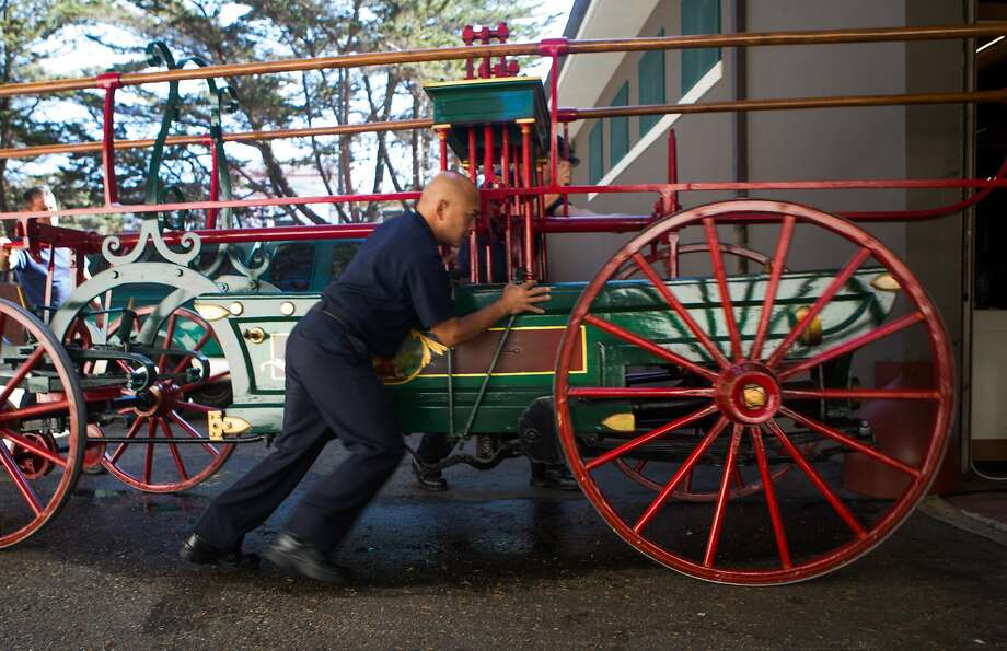 Alan Camarillo brings the newly acquired fire engine back to its resting place in the museum after being on display in the morning on Wednesday, Oct. 7, 2015 in San Francisco, Calif. San Francisco Fire Department Museum sees the return of the city's first ever fire engine built in 1855. Photo: Nathaniel Y. Downes, The Chronicle