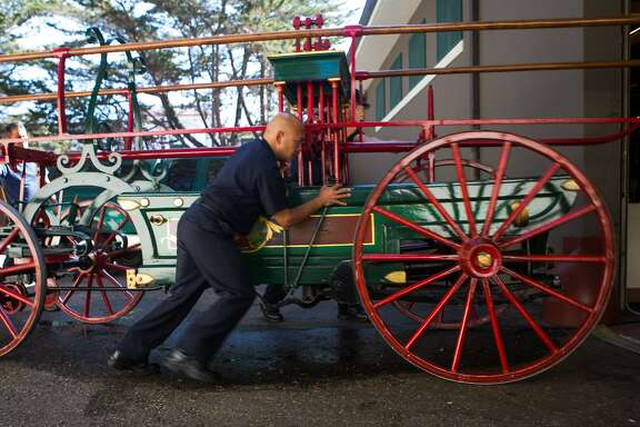 Alan Camarillo brings the newly acquired fire engine back to its resting place in the museum after being on display in the morning on Wednesday, Oct. 7, 2015 in San Francisco, Calif. San Francisco Fire Department Museum sees the return of the city's first ever fire engine built in 1855.