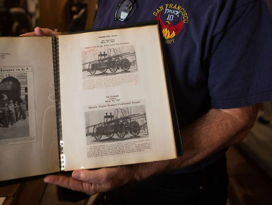Bill Koenig, director emeritus of the SFFD Museum, shows a photo album with clippings of Broderick, a fire engine built in 1855 on Wednesday, Oct. 7, 2015 in San Francisco, Calif. San Francisco Fire Department Museum sees the return of the city's first ever fire engine built in 1855. Photo: Nathaniel Y. Downes, The Chronicle