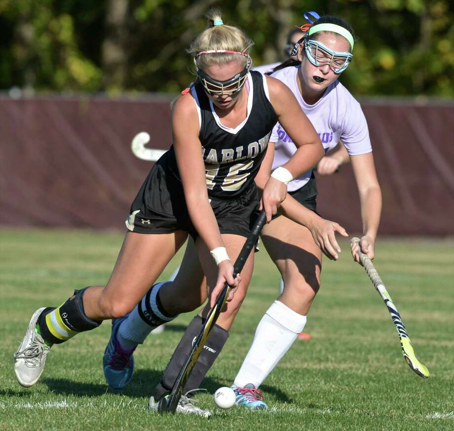 Joel Barlow's Libby Tower (16) controls the ball as Pomperaug's Kristen Gargano (14)  tries to get around her in the field hockey game between Joel Barlow and Pomperaug high schools, on Wednesday afternoon, October 7, 2015, at Pomperaug High School, Southbury, Conn. Photo: H John Voorhees III / Hearst Connecticut Media / The News-Times