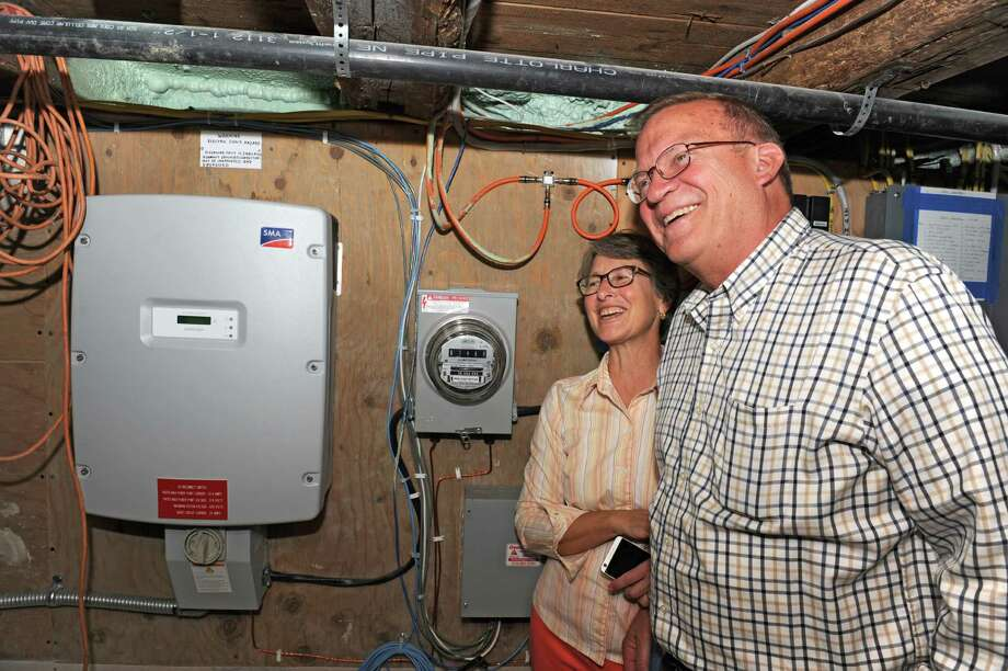 Joanne and Paul Coon show their solar energy inverter in their basement on Wednesday, Oct. 7, 2015 in Clifton Park, N.Y. (Lori Van Buren / Times Union) Photo: Lori Van Buren / 10033658A