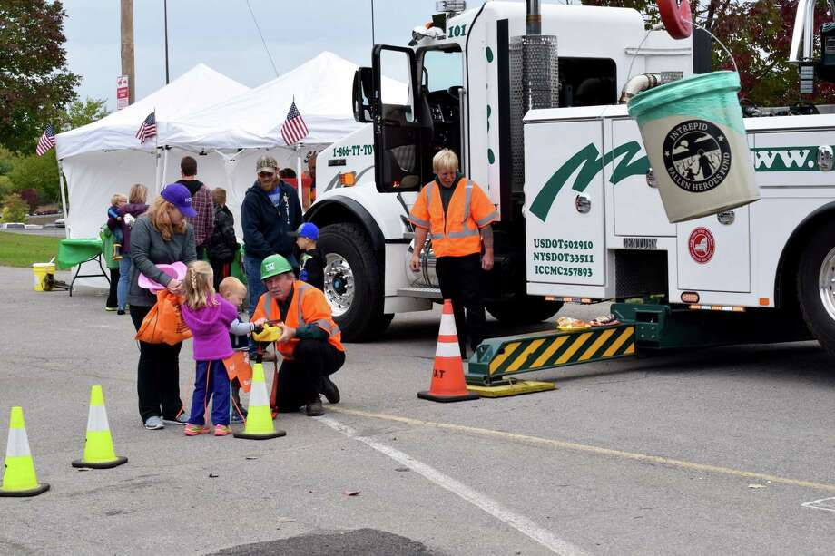 More than 600 children, parents and community members got up-close to big commercial and emergency vehicles at the second annual Operation: Big Wheels for Heroes event, held Oct. 3, 2015, at Crossgates Mall. The touch-a-truck event was hosted by Bestpass, Inc. and the New York State Motor Truck Association.  (Alex Wollyung)