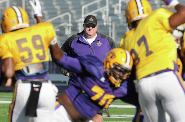 UAlbany head football coach Greg Gattuso watches his team practice field goal offense and defense at Bob Ford Field on Wednesday  Oct. 7, 2015 in Albany , N.Y.  (Michael P. Farrell/Times Union) Photo: Michael P. Farrell / 10033656A