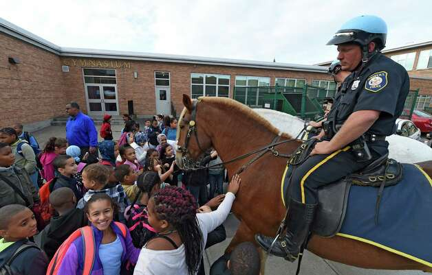 Giffen Elementary School students enjoy Earl the Mounted unit horse during the Walk to School Day Wednesday morning Oct. 7, 2015 in Albany, N.Y.   Sitting atop Earl is mounted unit officer Kurt Johnson  (Skip Dickstein/Times Union) Photo: SKIP DICKSTEIN / 10033663A
