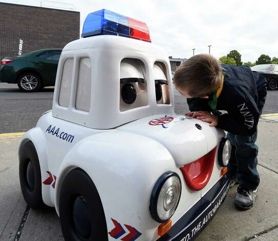 Giffen Elementary School student Mason Zwack, 4, checks out the AAA show car during the Walk to School Day program Wednesday morning Oct. 7, 2015 in Albany, N.Y.     (Skip Dickstein/Times Union) Photo: SKIP DICKSTEIN / 10033663A
