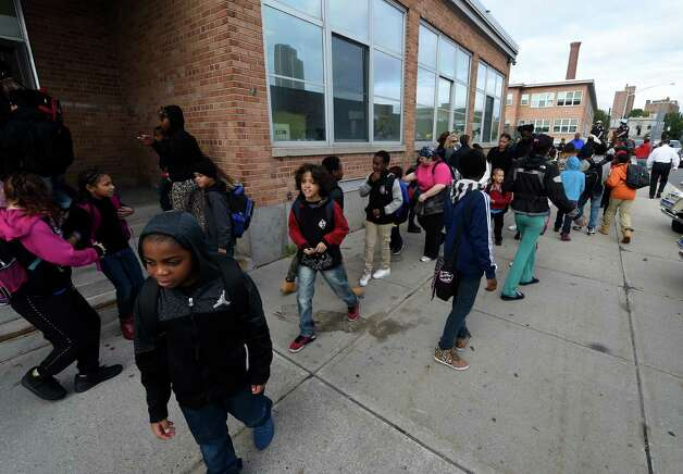 Giffen Elementary School students took part in the Walk to School Day Wednesday morning Oct. 7, 2015 in Albany, N.Y.     (Skip Dickstein/Times Union) Photo: SKIP DICKSTEIN / 10033663A