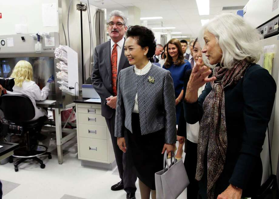 Peng Liyuan, center, the wife of Chinese President Xi Jinping, tours an HIV vaccine research lab Sept. 23 at the Fred Hutchison Cancer Research Center, which is one of the labs that says the tissues from fetuses have been crucial to the study of diseases and disorders.  Photo: Ted S. Warren, STF / AP