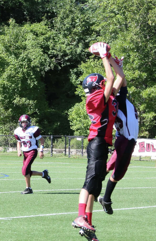 BANC Raiders wide receiver Brendan Friel leaps to make catch against the North Miauns Bulldogs. Oct. 3, 2015. Photo: Contributed Photo / Greenwich Time Contributed