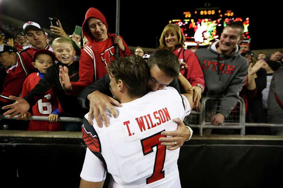 Utah quarterback Travis Wilson (7) hugs his family after an NCAA college football game against Oregon, Saturday, Sept. 26, 2015, in Eugene, Ore. (AP Photo/Ryan Kang) Photo: Ryan Kang / Associated Press / FR171219 AP