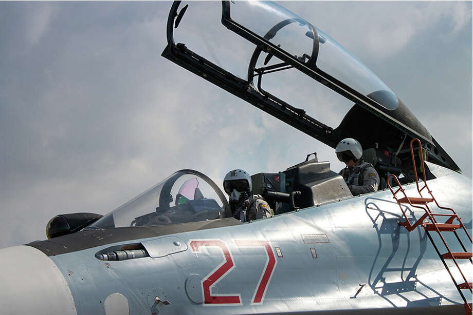 RETRANSMISSION TO ADD RESTRICTION - EDITORIAL USE ONLY -- In a photo released by the Russian Ministry of Defense, the flight crew of an Su-30 fighter are seen at their air base near Latakia, in northwest Syria. Russian officials say they are using the fighters and bombers at the base to target the Islamic State, though their bombs have mainly hit territories held by other insurgents who oppose Syrian President Bashar Assad, RussiaOs ally. (Russian Defense Ministry Press Service via The New York Times) - BEST QUALITY AVAILABLE - - EDITORIAL USE ONLY - ORG XMIT: NYT3 Photo: RUSSIAN DEFENSE MINISTRY PRESS SERVICE / RUSSIAN DEFENSE MINISTRY PRESS SERVICE