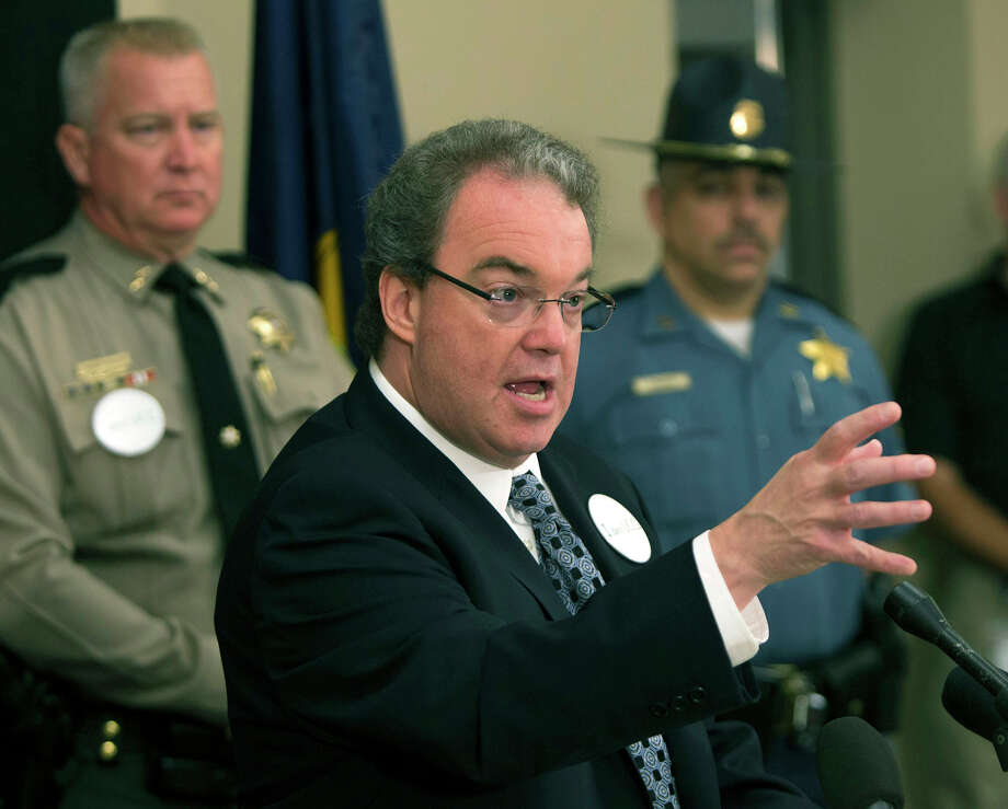 Douglas County District Attorney Rick Wesenberg, center, describes the events surrounding the officer involved shooting the morning of the mass murders at Umpqua Community College, during press conference in Roseburg, Ore.  (Chris Pietsch/The Register-Guard via AP) ORG XMIT: OREUG101 Photo: Chris Pietsch / The Register-Guard