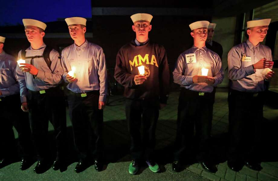 Maine Maritime Academy students attend a vigil of hope for the missing crew members of the U.S. container ship El Faro, Tuesday evening, Oct. 6, 2015, in Castine, Maine. The Coast Guard has concluded the vessel sank near the Bahamas during Hurricane Joaquin. (AP Photo/Robert F. Bukaty) ORG XMIT: MERB101 Photo: Robert F. Bukaty / AP