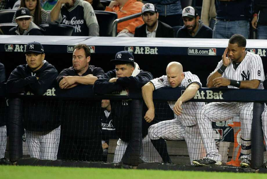 New York Yankees pitcher Masahiro Tanaka, far left, Dellin Betances, second from left, Brett Gardner, second from right, and Chris Young, right, watch from the dugout against the Houston Astros during the ninth inning of the American League wild card baseball game, Tuesday, Oct. 6, 2015, in New York. The Astros won 3-0 to advance to the American League Division Series. (AP Photo/Julie Jacobson) ORG XMIT: NYY232 Photo: Julie Jacobson / AP
