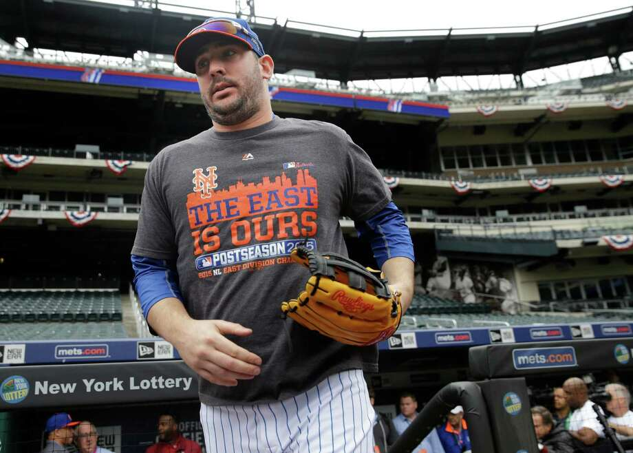 New York Mets' pitcher Matt Harvey runs out onto the field before a workout at Citi Field, Wednesday, Oct. 7, 2015 in New York. The Mets will play the Los Angeles Dodgers in a National League Division Series starting Friday in Los Angeles. (AP Photo/Seth Wenig) ORG XMIT: NYSW101 Photo: Seth Wenig / AP