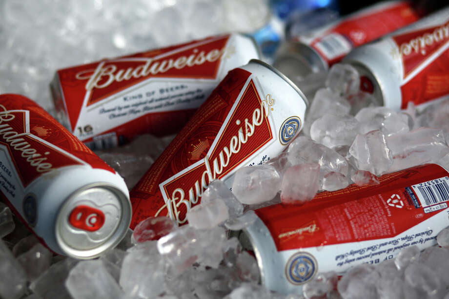 FILE - In this Thursday, March 5, 2015 file photo, Budweiser beer cans at a concession stand at McKechnie Field in Bradenton, Florida, USA.  Anheuser-Busch InBev, the owner of the world's biggest brewer Budweiser, on Wednesday Oct. 7, 2015, raised its takeover offer for rival SABMiller to more than 68 billion pounds ($104 billion), but the offer was rejected. (AP Photo/Gene J. Puskar, File) Photo: Gene J. Puskar, STF / AP