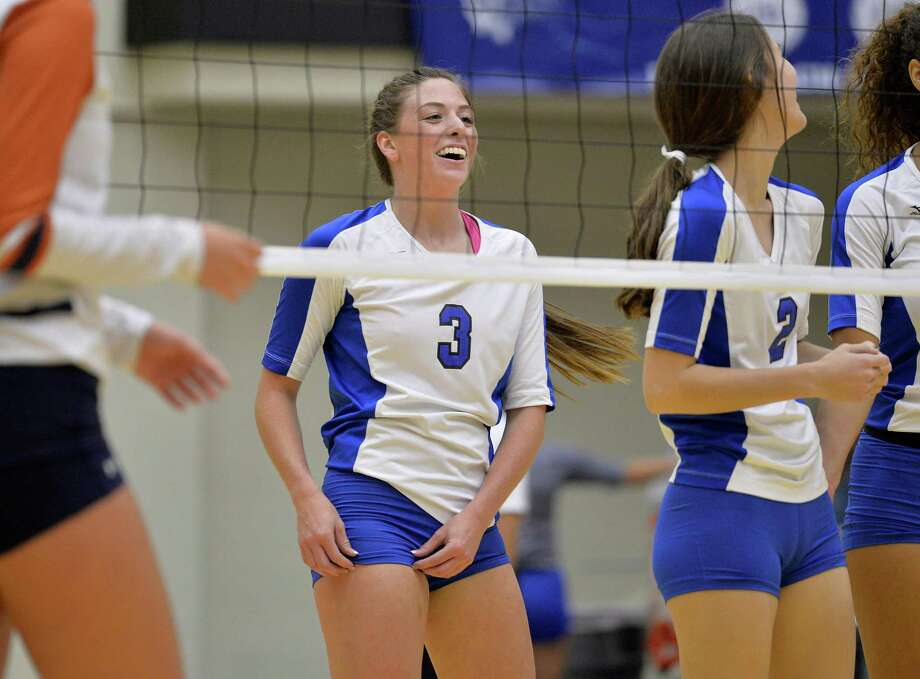 MacArthur's Madison Trawick (3) celebrates a point with teammates during a District 26-6A high school volleyball match against Madison, Tuesday, Oct. 6, 2015, at Littleton Gymn in San Antonio. Photo: Darren Abate /For The Express-News / San Antonio Express-News