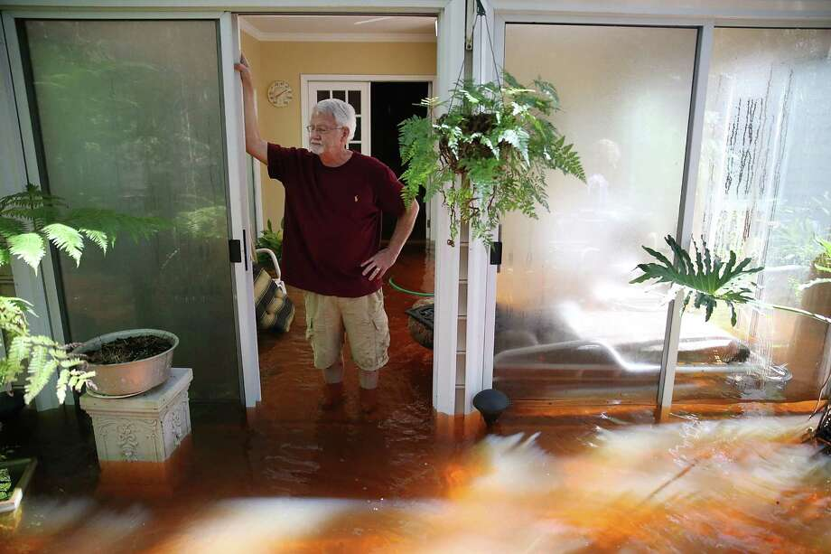 SUMMERVILLE, SC - OCTOBER 07: Nelson Shields stands in his flooded home on October 7, 2015 in Summerville, South Carolina.   The state of South Carolina experienced record rainfall amounts over the weekend and officials expect the damage from the flood waters to be in the billions of dollars.  (Photo by Joe Raedle/Getty Images) *** BESTPIX *** Photo: Joe Raedle, Staff / 2015 Getty Images